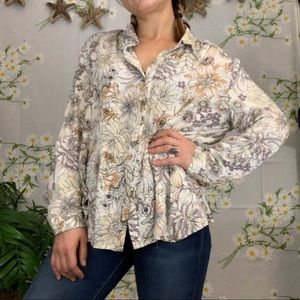 ANTHROPOLOGIE muted floral ruffle hem blouse